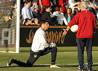 Goalkeeper Tony Meola stretches while talking with goalkeeper coach Milutin Soskic. The USA tied Jamaica 1-1 at SAS Soccer Park in Cary, N.C. on April 11, 2006.