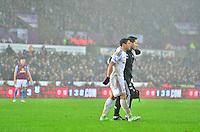 Pictured: Friday 26 December 2014<br /> Re: Premier League, Swansea City FC v Aston Villa at the Liberty Stadium, Swansea, south Wales, UK.<br /> <br /> Swansea's Jefferson Montero taken off with an injury