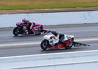 May 5, 2019; Commerce, GA, USA; NHRA pro stock motorcycle rider Steve Johnson (near) races alongside Angie Smith during the Southern Nationals at Atlanta Dragway. Mandatory Credit: Mark J. Rebilas-USA TODAY Sports