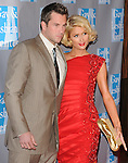 Paris Hilton & Doug Reinhardt at 'AN EVENING WITH WOMEN: Celebrating Art, Music & Equality' held at The Beverly Hilton Hotel in Beverly Hills, California on April 24,2009                                                                     Copyright 2009 DVS / RockinExposures
