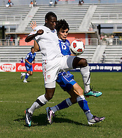 Alfred Koroma (7) of the United States fights for the ball with Olivier Ayala (15) of El Salvador during the quarterfinals of the CONCACAF Men's Under 17 Championship at Catherine Hall Stadium in Montego Bay, Jamaica. The USA defeated El Salvador, 3-2, in overtime.