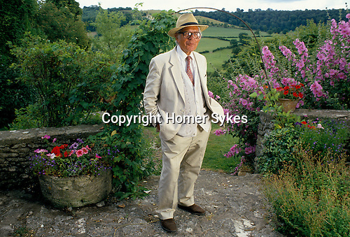 Laurie Lee author in the garden of his home Slad near Stroud Gloucestershire. 1994, 1990s,