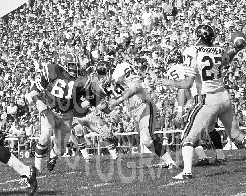 Ed McQuarters Saskatchewan Roughriders  against BC Lions 1971. Copyright photograph Scott Grant
