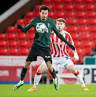 23rd December 2020; Bet365 Stadium, Stoke, Staffordshire, England; English Football League Cup Football, Carabao Cup, Stoke City versus Tottenham Hotspur; Dele Alli of Tottenham Hotspur under pressure from Nathan Collins of Stoke City