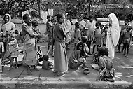 """Calcutta, India. April 04, 1975.<br /> Each day, Mother Teresa walked the streets of Calcutta. People paid her devotion as she passed, and in turn she showed interest in them and gave them her blessing. Mother Teresa (Agnes Gonxha Boyaxihu) the Roman Catholic, Albanian nun revered as India's """"Saint of the Slums,"""" was awarded the 1979 Nobel Peace Prize."""