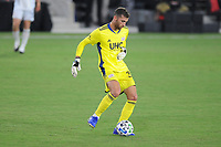 WASHINGTON, DC - AUGUST 25: Matt Turner #30 of New England Revolution passes off the ball during a game between New England Revolution and D.C. United at Audi Field on August 25, 2020 in Washington, DC.