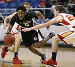 Word of Life's Trent McCall drives through Whittell defenders Palmer Chaplin, left, and Caleb Moretti during the NIAA Division IV state basketball championship in Reno, Nev. on Saturday, Feb. 27, 2016. Whittell won 53-48. Cathleen Allison/Las Vegas Review-Journal