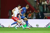 8th September 2021; PGE National Stadium, Warsaw, Poland: FIFA World Cup 2022 Football qualification, Poland versus England;  ROBERT LEWANDOWSKI and JOHN STONES