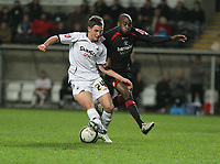 Pictured L-R: Joe Allen of Swansea challenged by Jamal Campbell-Ryce of Barnsley<br /> Re: Coca Cola Championship, Swansea City FC v Barnsley at the Liberty Stadium. Swansea, south Wales, Tuesday 09 December 2008.<br /> Picture by D Legakis Photography / Athena Picture Agency, Swansea 07815441513