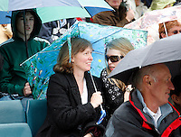 27-6-07,England, Wimbldon, Tennis, Rain at Wimbledon, Keep on smiling under the umbrella