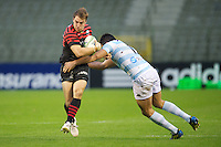 20121020 Copyright onEdition 2012©.Free for editorial use image, please credit: onEdition..Chris Wyles of Saracens forces his way through the tackle of Fabrice Estebanez of Racing Metro 92 during the Heineken Cup Round 2 match between Saracens and Racing Metro 92 at the King Baudouin Stadium, Brussels on Saturday 20th October 2012 (Photo by Rob Munro)..For press contacts contact: Sam Feasey at brandRapport on M: +44 (0)7717 757114 E: SFeasey@brand-rapport.com..If you require a higher resolution image or you have any other onEdition photographic enquiries, please contact onEdition on 0845 900 2 900 or email info@onEdition.com.This image is copyright the onEdition 2012©..This image has been supplied by onEdition and must be credited onEdition. The author is asserting his full Moral rights in relation to the publication of this image. Rights for onward transmission of any image or file is not granted or implied. Changing or deleting Copyright information is illegal as specified in the Copyright, Design and Patents Act 1988. If you are in any way unsure of your right to publish this image please contact onEdition on 0845 900 2 900 or email info@onEdition.com