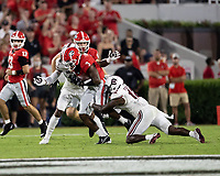 ATHENS, GA - SEPTEMBER 18: Zamir White #3 is tackled by R.J. Roderick #10 and Jaylan Foster #12 during a game between South Carolina Gamecocks and Georgia Bulldogs at Sanford Stadium on September 18, 2021 in Athens, Georgia.