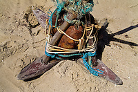A handmade anchor, made of metal bodies of the aerial bombs stolen from a military base, seen on the beach of Prainha, Ceará state, northeastern Brazil, 9 March 2004. Jangadeiros, working on a unique wooden raft boat called jangada, keep the tradition of artisan fishing for more than four hundred years. However, being a fisherman on jangada is highly dangerous job. Jangadeiros spend up to several days on high-sea, sailing tens of kilometres far from the coast, with no navigation on board. In the last two decades jangadeiros have been facing up the pressure from motorized vessels which use modern, effective (and environmentally destructive) fishing methods. Every time jangadeiros come back from the sea with less fish.