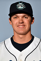 Asheville Tourists pitcher Garrett Schilling (18) poses for a photo at Story Point Media on April 3, 2017 in Asheville, North Carolina. (Tony Farlow/Four Seam Images)