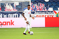 KANSASCITY, KS - JULY 11: Mark-Anthony Kaye #14 of Canada with the ball during a game between Canada and Martinique at Children's Mercy Park on July 11, 2021 in KansasCity, Kansas.