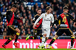 Luka Modric of Real Madrid (R) is surrounded by players of Rayo Vallecano during the La Liga 2018-19 match between Real Madrid and Rayo Vallencano at Estadio Santiago Bernabeu on December 15 2018 in Madrid, Spain. Photo by Diego Souto / Power Sport Images