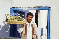 Tunisia, Sidi Bou Said.  Jasmine Vendor Saleh Bahri, in Traditional Tunisian Clothes.
