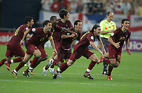 The Portuguese team, headed by Maniche (18) and Helder Postiga (23) rush to join their goalkeeper (1) Ricardo at the end of the game.  Portugal defeated England on penalty kicks after playing to a 0-0 tie in regulation in their FIFA World Cup quarterfinal match at FIFA World Cup Stadium in Gelsenkirchen, Germany, July 1, 2006.