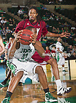 North Texas Mean Green forward Roger Franklin (32) and Troy Trojans forward Tim Owens (42) in action during the game between the Troy Trojans and the University of North Texas Mean Green at the North Texas Coliseum,the Super Pit, in Denton, Texas. UNT defeats Troy 87 to 65.....