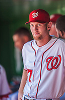 25 July 2013: Washington Nationals pitcher Stephen Strasburg watches play from the dugout during a game against the Pittsburgh Pirates at Nationals Park in Washington, DC. The Nationals salvaged the last game of their series, winning 9-7 ending their 6-game losing streak. Mandatory Credit: Ed Wolfstein Photo *** RAW (NEF) Image File Available ***