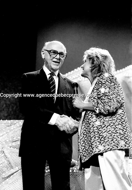 July 10, 1985 File Photo - Jean Drapeau, Mayor of Montreal (L) and Dominique Michel host of the<br />   JUSTE POUR RIRE Festival gala held at Saint-Denis Theater