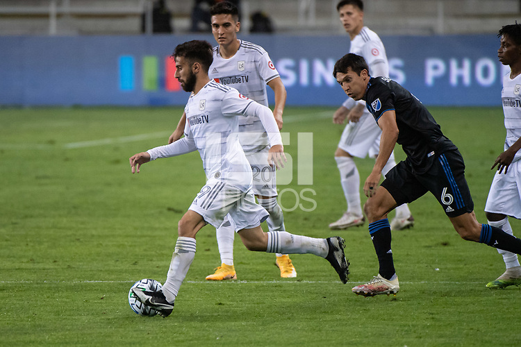 SAN JOSE, CA - NOVEMBER 04: Diego Rossi #9 of the Los Angeles FC escapes Shea Salinas #6 of the San Jose Earthquakes during a game between Los Angeles FC and San Jose Earthquakes at Earthquakes Stadium on November 04, 2020 in San Jose, California.