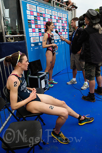 31 MAY 2014 - LONDON, GBR - Gwen Jorgensen (USA) (foreground) of the USA waits to be interviewed for television after winning the elite women's 2014 ITU World Triathlon Series round in Hyde Park, London, Great Britain (PHOTO COPYRIGHT © 2014 NIGEL FARROW, ALL RIGHTS RESERVED)