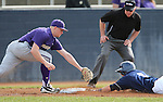 Davis' Evan Heptig slides safely under the tag of Washington's Alex Schmidt during a college baseball game between the Washington Huskies and the Davis Aggies, in Davis, Ca., on Saturday, Feb. 16, 2013. Davis won the opener 6-5 and dropped the second game 3-2..Photo by Cathleen Allison