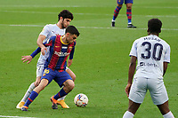 19th December 2020; Camp Nou, Barcelona, Catalonia, Spain; La Liga Football, Barcelona versus Valencia;  Pedri of Barca holds off the challenge from Goncalo Guedes