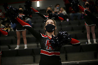A Pea Ridge cheerleader cheers, Friday, January 8, 2021 during a basketball game at Pea Ridge High School in Pea Ridge. Check out nwaonline.com/210108Daily/ for today's photo gallery. <br /> (NWA Democrat-Gazette/Charlie Kaijo)