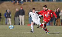 St. Lawrence midfielder Jonathan Mendoza (5) passes the ball as Amherst midfielder Tommy Haskel (7) defends. NCAA Division III Sectionals. In double-overtime, Amherst College (white) defeated St. Lawrence University (red), 2-1, on Hitchcock Field at Amherst College on November 23, 2013.