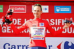 Race leader Rein Taaramäe (EST) Intermarché-Wanty-Gobert Matériaux retains the Red Jersey at the end of Stage 4 of La Vuelta d'Espana 2021, running 163.9km from Burgo de Osma to Molina de Aragon, Spain. 17th August 2021.    <br /> Picture: Luis Angel Gomez/Photogomezsport | Cyclefile<br /> <br /> All photos usage must carry mandatory copyright credit (© Cyclefile | Luis Angel Gomez/Photogomezsport)