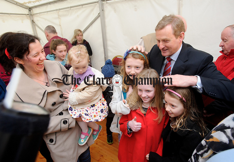 Enda Kenny, Taoiseach poses for pictures with local children during his visit to Loop Head to launch the Fine Gael tourism initiative. Photograph by John Kelly.