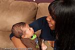 3 week old newborn baby boy with mother held alert listening to her talk