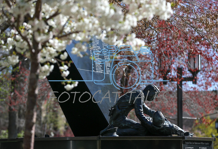 The Nevada Law Enforcement Officers Memorial surrounded by spring blooms on the Capital grounds in Carson City, Nev., on Monday, March 30, 2015. <br /> Photo by Cathleen Allison