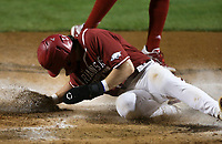 Arkansas Cayden Wallace (7) scores, Saturday, June 5, 2021 during the sixth inning in the second game of the NCAA Fayetteville Regional at Baum-Walker Stadium in Fayetteville. Check out nwaonline.com/210606Daily/ for today's photo gallery. <br /> (NWA Democrat-Gazette/Charlie Kaijo)