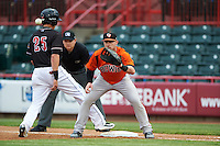 Bowie Baysox first baseman Joey Terdoslavich (7) waits for a throw as Dominic Ficociello (25) gets back to the bag with umpire Mike Provine looking on during a game against the Erie SeaWolves on May 12, 2016 at Jerry Uht Park in Erie, Pennsylvania.  Bowie defeated Erie 6-5.  (Mike Janes/Four Seam Images)