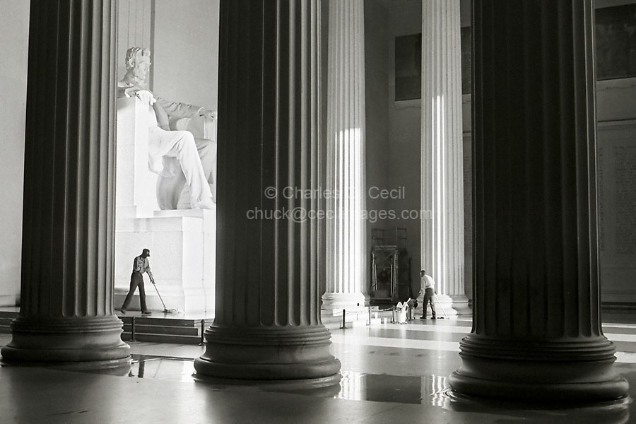 """Washington, D.C., USA.  """"Emancipation Proclamation""""; Two Black Americans Mop the Floor of the Lincoln Memorial in early Morning."""
