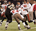 December 2009: New Orleans Saints wide receiver Marques Colston (12) fumbles the ball during an NFL football game at the Louisiana Superdome in New Orleans.  The Buccaneers defeated the Saints 20-17.