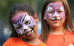 Sam Baca, left, and Adilyn Kobs, both 5, show off their face paint at the 16th annual National Night Out event, hosted by the Carson City Sheriff's Office, in Carson City, Nev., on Tuesday, Aug. 7, 2018.<br /> Photo by Cathleen Allison/Nevada Momentum
