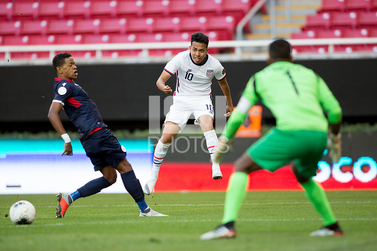 ZAPOPAN, MEXICO - MARCH 21: Sebastian Saucedo #10 of the United States crosses a ball into the box during a game between Dominican Republic and USMNT U-23 at Estadio Akron on March 21, 2021 in Zapopan, Mexico.