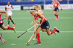 The Hague, Netherlands, June 10: Emily Wold #13 of USA runs with the ball during the field hockey group match (Women - Group B) between USA and South Africa on June 10, 2014 during the World Cup 2014 at GreenFields Stadium in The Hague, Netherlands. Final score 4-2 (1-0) (Photo by Dirk Markgraf / www.265-images.com) *** Local caption ***