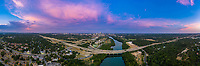 "On a beautiful summer's evening, this aerial panorama photograph of downtown Austin and the skyline taking from the Zilker Clubhouse over Lady Bird Lake shows pink cloud formations sometimes called the ""violet crown"" found above the Austin Cityscape. Inset, the Mopac Loop 1 expressway is Austin busiest highway in Austin's transportation corridor. In the far distance, the ""Jenga Tower"" (formally known as the Independent) tops out at 685' and is the tallest highrise in Austin's ever booming skyline, narrowly eclipsing the Austonian (683')."