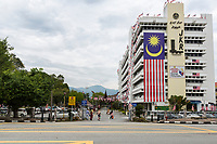 Malaysian Flag Decorates Government Building, Ipoh, Malaysia.  Public Works Department of Perak State.