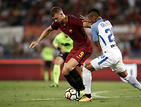 Calcio, Serie A: Roma, stadio Olimpico, 26 agosto, 2017.<br /> Roma's Edin Dzeko (l) in action with Inter's Henrique Dalbert (r) during the Italian Serie A football match between Roma and Inter at Rome's Olympic stadium, August 26, 2017.<br /> UPDATE IMAGES PRESS/Isabella Bonotto