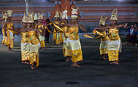 Bali, Indonesia.  Adolescent Girls Performing a Dance as Part of a Religious Ceremony Praying for a Bountiful Rice Harvest.  Dlod Blungbang Village, Pura Dalem Temple.