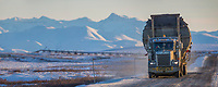 Panorama of oversize truck on the James Dalton Highway Philip Smith Mountains of the Brooks Range in the distance, Arctic, Alaska.