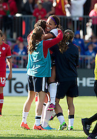 02 June 2013: U.S. Women's National Team forward Abby Wambach #20 celebrates the win with U.S. Women's National Team forward Sydney Leroux #2 at the end of an International Friendly soccer match between the U.S. Women's National Soccer Team and the Canadian Women's National Soccer Team at BMO Field in Toronto, Ontario.<br /> The U.S. Women's National Team Won 3-0.