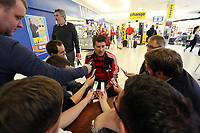 Wednesday 28 August 2013<br /> Pictured: Michael Laudrup (C) interviewed by members of the press at Cardiff Airport.<br /> Re: Swansea City FC players and staff en route for their UEFA Europa League, play off round, 2nd leg, against Petrolul Ploiesti in Romania.