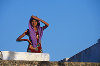 Pretty Local teenage village Girl on a rooftop in the traditional village of Narhet, Rajasthan, India
